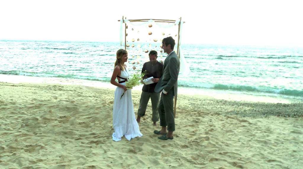 Two castaways getting married on a secluded beach